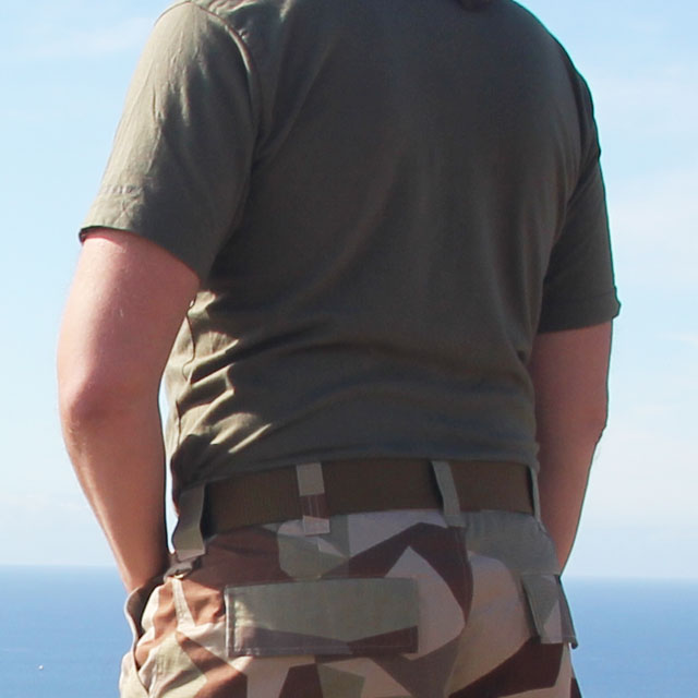 Worn Expedition Belt Coyote on camo shorts.
