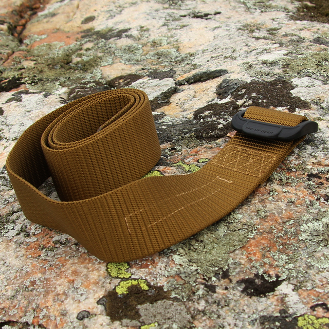 Outdoors photo with stone and lava background of a Expedition Belt Coyote.