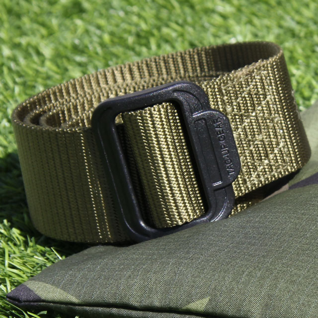 Photo in the sun of a rolled Expedition Belt Green.