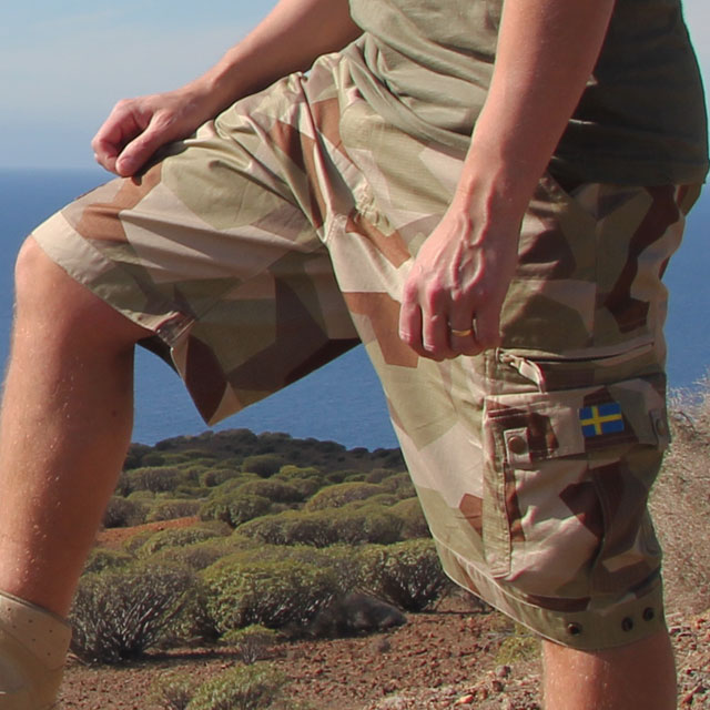 Sideview of a Camp Shorts M90K Desert worn on model in warm environment.