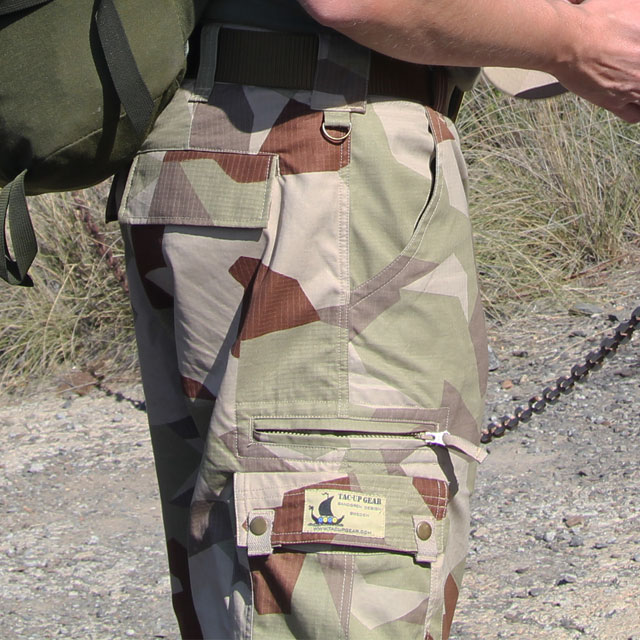 Camp Shorts M90K Desert in close up showing waist and thigh pockets.