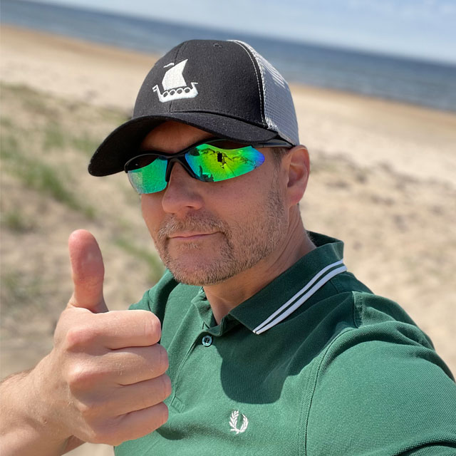 Mesh Cap Black and Grey from TAC-UP GEAR worn on model on a beach in Sweden