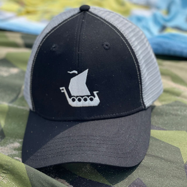 Mesh Cap Black and Grey on a Tarp Light M90 on the beach