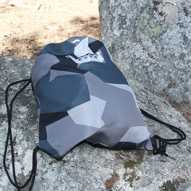 The great looking Drawstring Sports Bag M90 Grey seen on a large stone