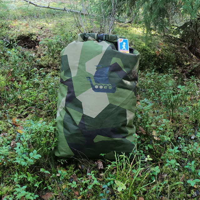 M90 camouflage dry sack (large size) in Swedish wooded scenery