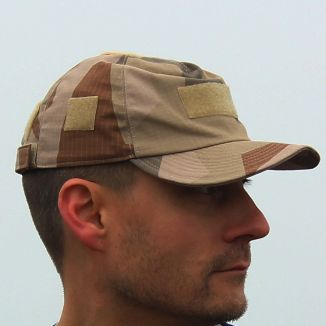Sideview of a Field Cap M90K Desert worn outside on photoshoot.