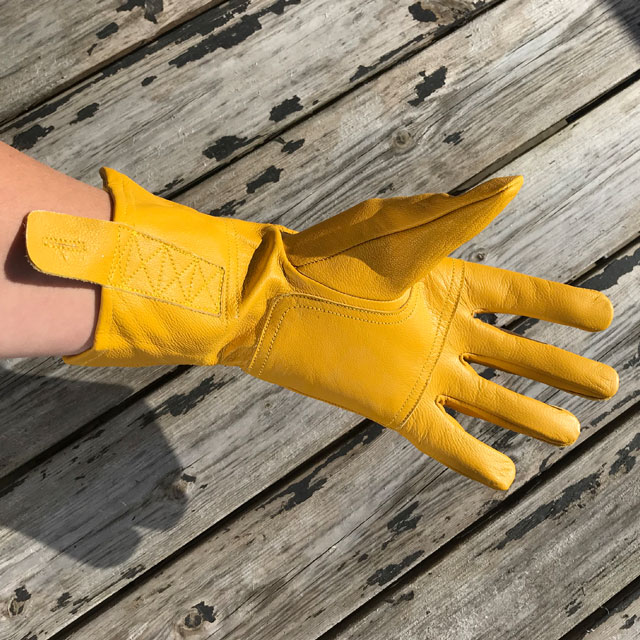 Palm and wrist area on a yellow color Bushcraft Leather Glove.