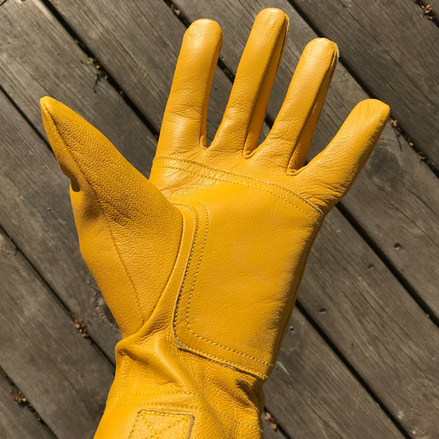 Open hand on a yellow goatskin Bushcraft Leather Glove.