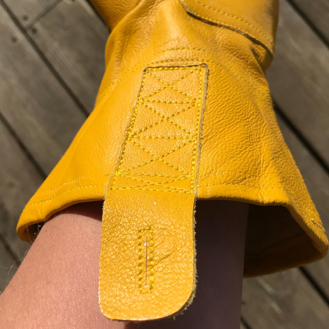 Wrist hanger on a yellow goatskin Bushcraft Leather Glove.