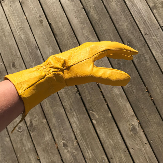 Sideview of a yellow goatskin Bushcraft Leather Glove.