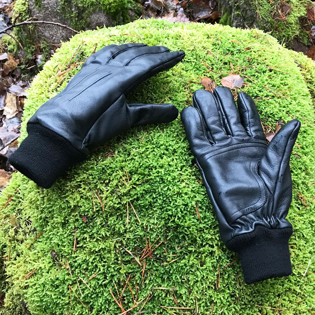 Officer Black Leather Gloves on a mossy stone in Swedish nature.