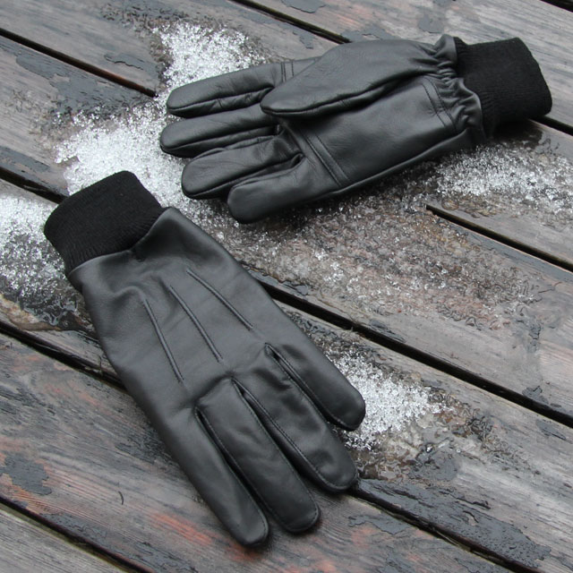 Snow and wood background in photo of a pair Officer Black Leather Gloves.