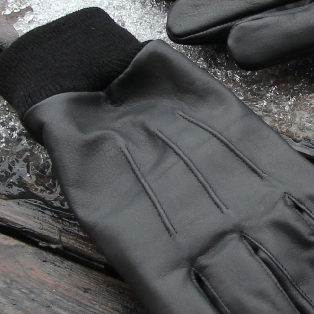 Three stripe upper close up on a Officer Black Leather Glove.