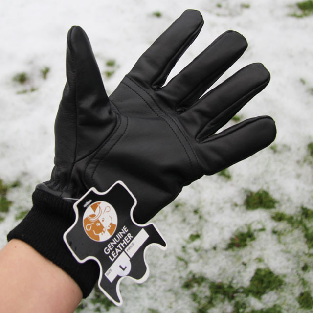 Palm area and genuine leather badge on a Officer Black Leather Glove.