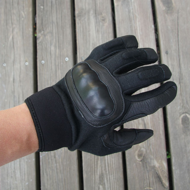 Black knuckle protected tactical glove.