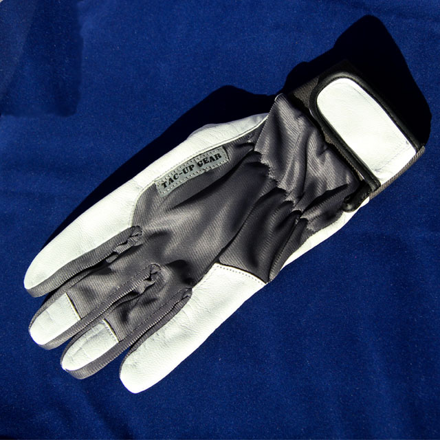 Showing full glove on blue background.