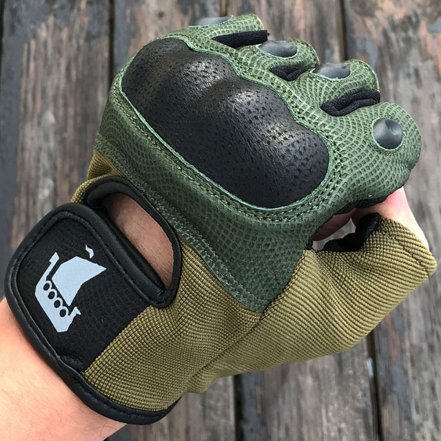 Clenched fist in a Short Finger Tactical Glove Green.