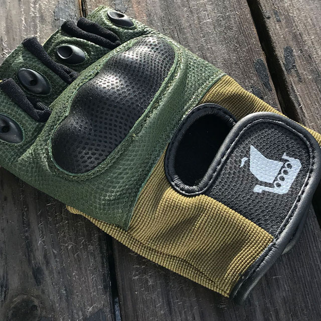 Close up on a Short Finger Tactical Glove Green.