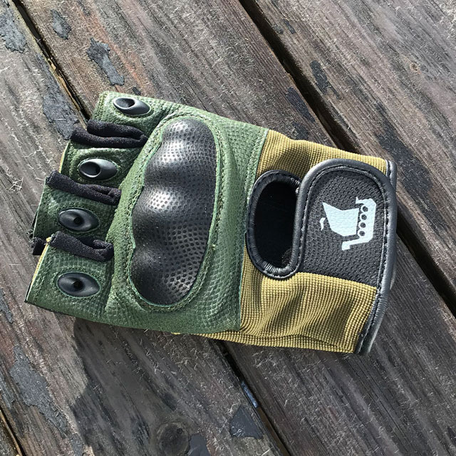 Short Finger Tactical Glove Green loose on the ground.
