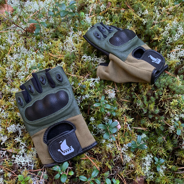 A pair of Short Finger Tactical Glove Green on the forest floor
