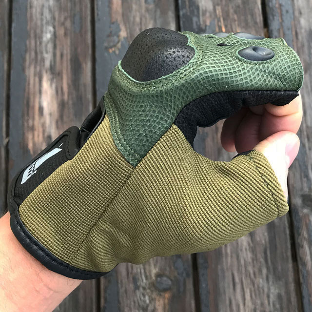 Reptile type look on  a side view  of a Short Finger Tactical Glove Green