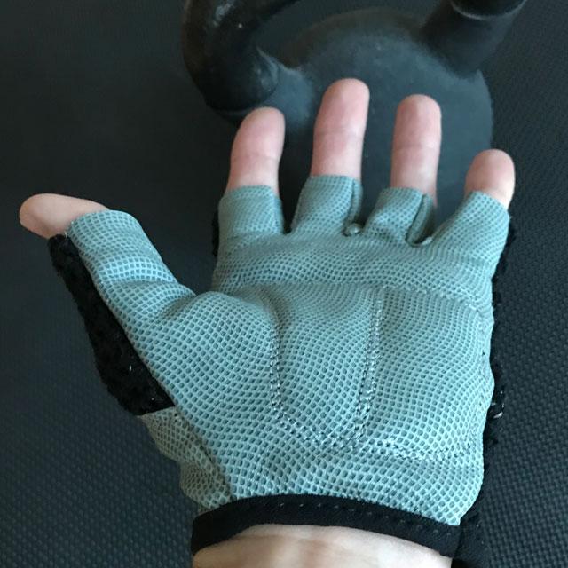 Grey grip friendly palm area of a Training Glove Net Black.