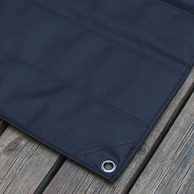 Backside and corner with eyelet of a Kardborre Wall Mat Display Black.