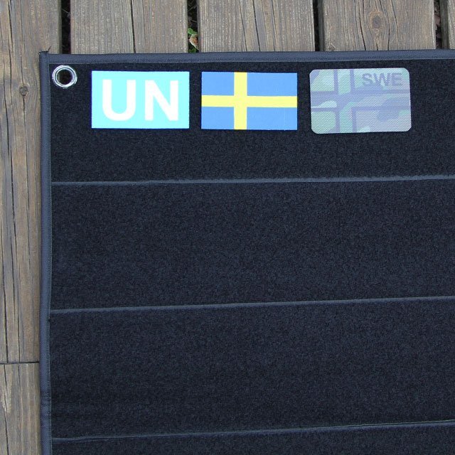Eyelet and Swedish flag patches on a Kardborre Wall Mat Display Black.