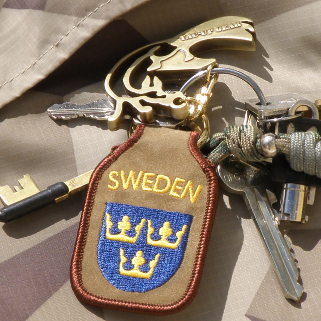A Keyring SWE Desert with keys attached.