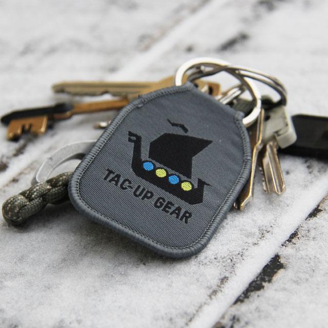 A M90 Keyring TUG with keys on frosty background.