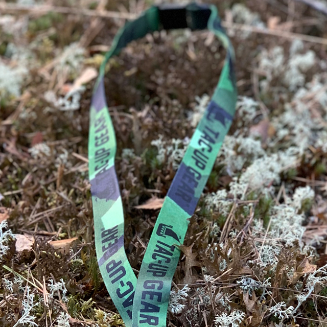 M90 Neck Lanyard in and out f focus on moss