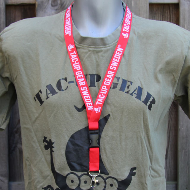 Worn on the neck on a mannequin is the Lanyard Red/White.