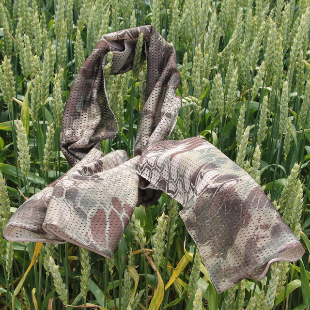 Product photo of a Sniper Scarf Dragon on green summer crop in Swedish nature.