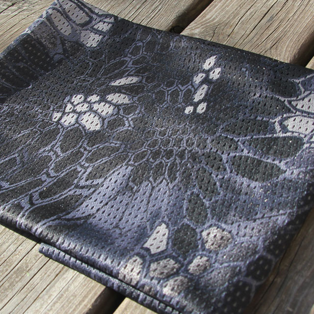 Sunny picture showing the camouflage on a Mesh Scarf Dragon Blue.