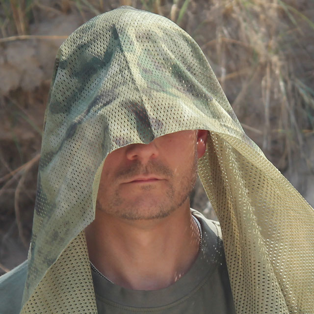 Worn as drape over head is a Sniper Scarf Marshland.