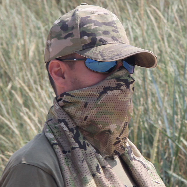 A Mesh Scarf Multicam used as face veil