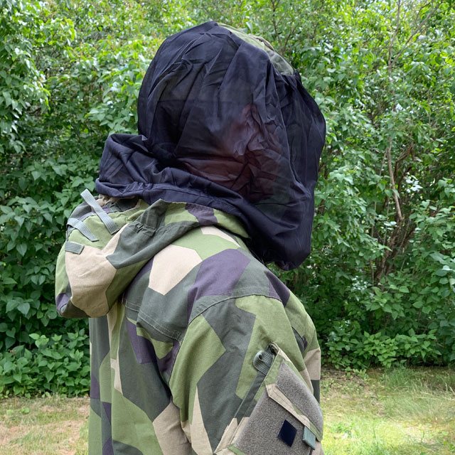 Slightly seen from behind a protective Mosquito Head Net Black/M90