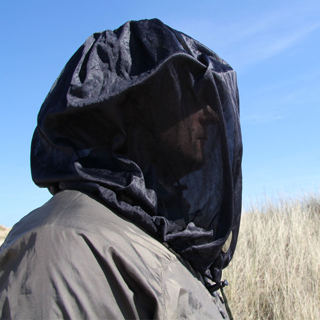 Side view of a model draped over head with a Mosquito Head Net Black/M90