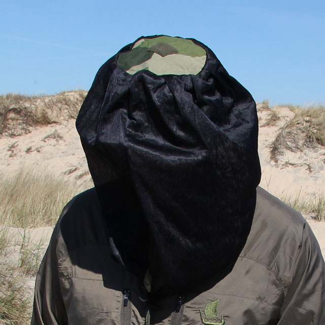 The M90 camouflage print clearly visible on the top of the Mosquito Head Net Black/M90