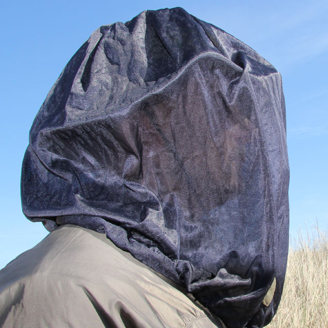 Mosquito Head Net Black/M90 draped over head, face barley visible