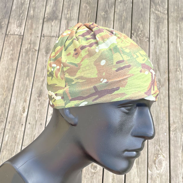 The Multiwrap Coolmax Camo from TAC-UP GEAR used as a beanie on a mannequin