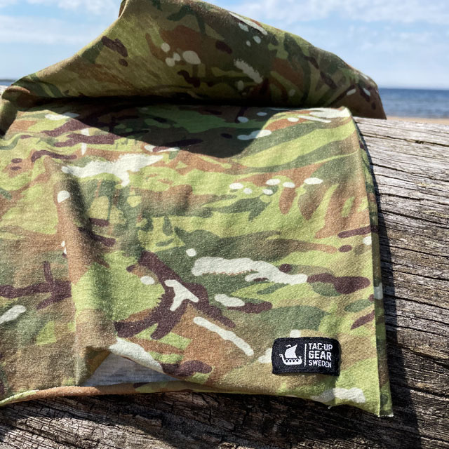 A Multiwrap Coolmax Camo from TAC-UP GEAR seen lying flat on a log