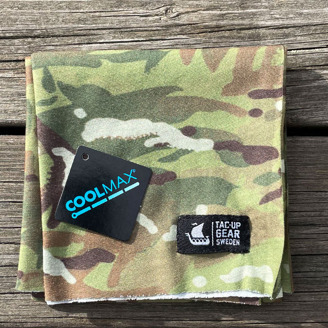 A folded The Multiwrap Coolmax Camo from TAC-UP GEAR