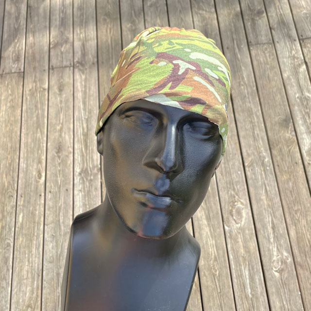 The Multiwrap Coolmax Camo from TAC-UP GEAR used as a beanie seen from the front