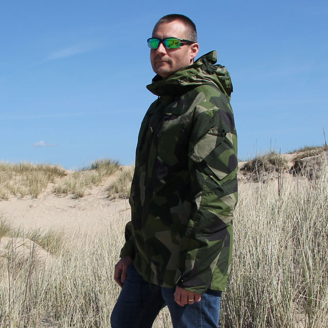 The hood on the NCWR Jacket M90 will in its down position help shield your neckfrom wind and rain