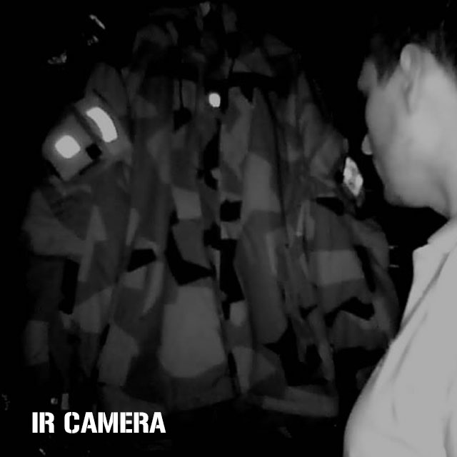 IR Camera photo in dark room showing clearly reflective IR patches mounted on NCWR Jacket