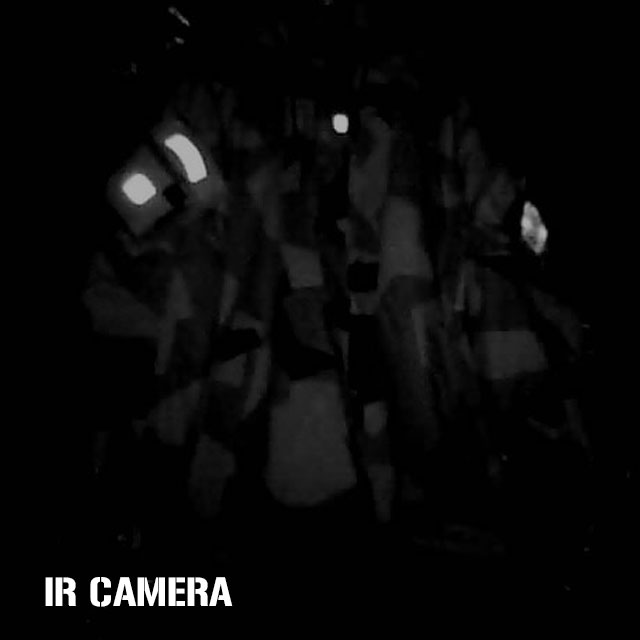 IR Camera photo in dark room showing the difference in NCWR Jacket M90 and reflective IR patches when in low IR light