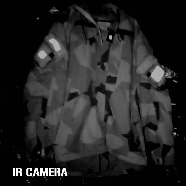 Medium IR light source in a darkened room shone on a NCWR Jacket M90 with IR reflective patches on it