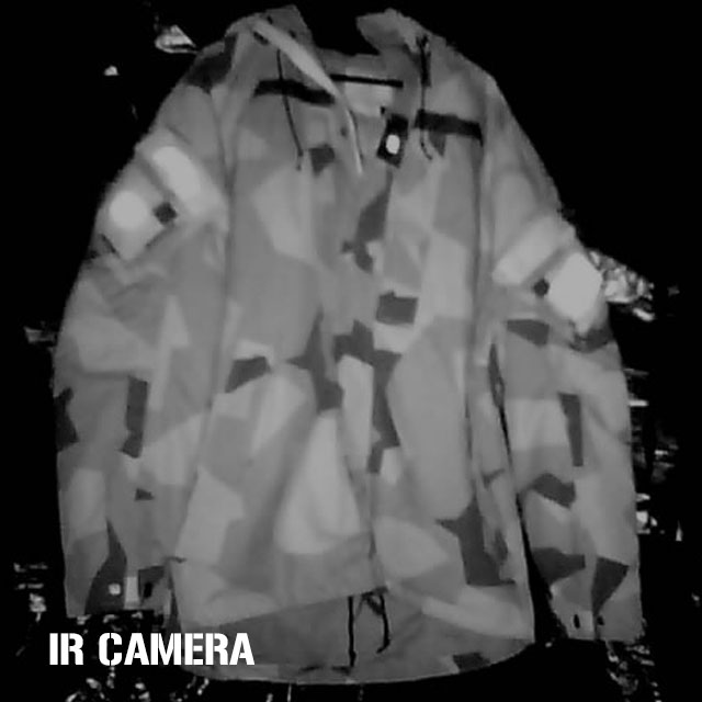 Full blast with four IR light sources in a darkened room shone on a NCWR Jacket M90 with IR reflective patches on it, note M90 camouflage pattern is still visible