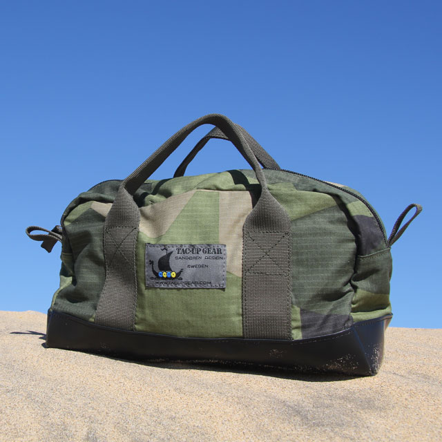 Necessär M90 during photoshoot in the blue sky and sandy desert.